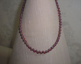 Red and purple single strand beaded necklace