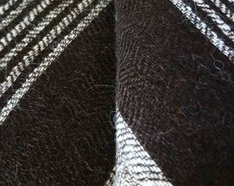100% Alpaca Hand woven Shawl in black and cream striped design.