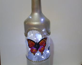 Large liqueur bottle Lamp in white gold metallic paint with butterflies.
