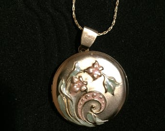 Gold locket with a floral design