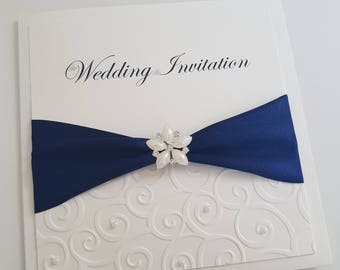 Embossed embellished wedding invitation