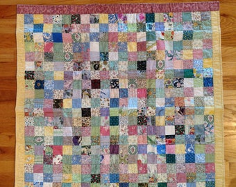 Vintage Holly Hobbie Baby Quilt - Features a Variety of Quilted Squares in Mini Prints Backed By a Buttery Yellow Holly Hobbie Fabric