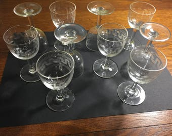 Set of 10 stylish liquor glasses, elegant engraving.