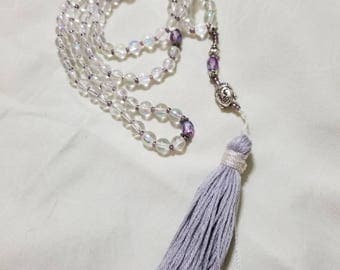 clear glass with light purple glass beads