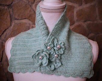 Knitted in Tiffany green wool with flowers
