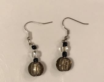 Neutral colored dangle earrings