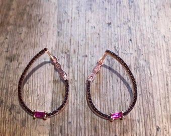 black hoops with pink zircon