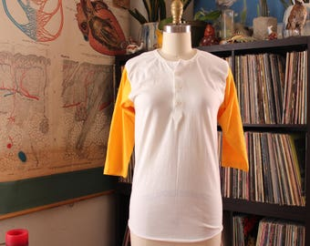 80s vintage henley tee, womens xs small, mens xxs xs . white t-shirt with yellow 3/4 sleeves by Russell Athletic
