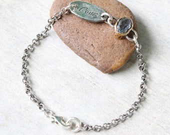 LOVE,Oval faceted blue topaz bracelet in brass bezel setting and sterling silver oxidized rolo chain