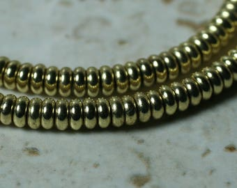 Gold tone rondelle beads 4mm in diameter 2mm thick aprox 1.5mm hole, 12 pcs (item ID FA2593MB)
