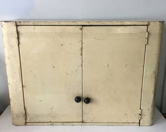 Vintage Medicine Cabinet Wall Mount Cream Metal with Three Shelves Tight Latch Door Curved Art Deco Lines