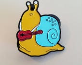 Give him a hand. Snail Pin