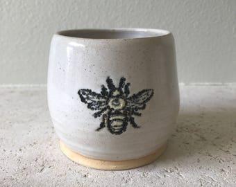 Porcelain stoneware carved bee tumbler.