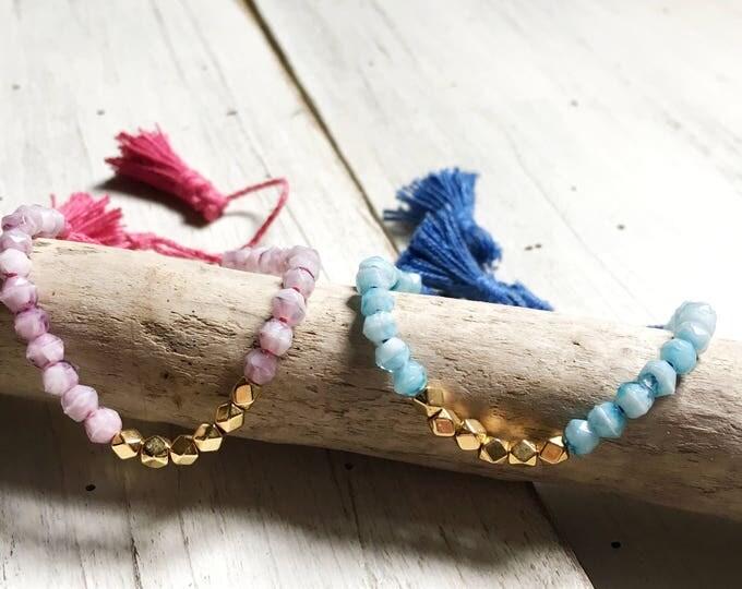 Pompoms bracelet with vintage beads . little serie