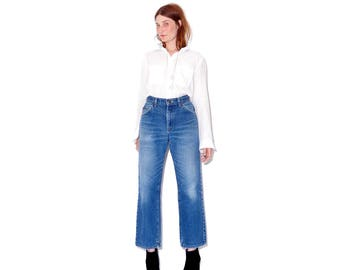 broken in to perfection amazing VINTAGE LEE JEANS / boyfriend jeans high waisted jeans vintage jeans mom jeans 70s 80s leather patch lees