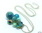 Precious Gipsy . Sautoir unique Bubbles grappe perles bleu globe verre cristal bohème design original Tikaille