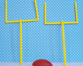 "Football Goalposts and Football Cake Toppers , Goalposts are 5 1/2""h, Football is 1 5/8"" w"