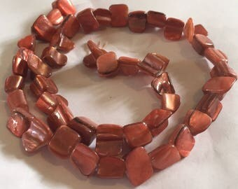 1 x strand of dyed orange shell beads approx 8mm 48beads