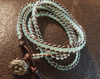 Beautiful Swarovski Pacific Opal Crystal wrapped leather cord bracelet with green girl nest bead closure stunning