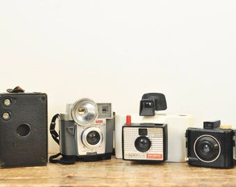 Vintage Camera Display Lot of Four Cameras Antique Decorative Box Baby Brownie Kodak Flashmite Polaroid Land Shinger Model 20