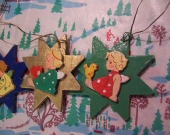 three adorable wooden star ornaments