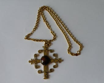 Anne Klein for Accessocraft cross pendant necklace. Brown glass cabochon.