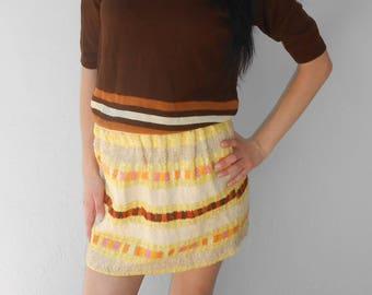 Vintage 1970s yellow, brown, & beige macrame mini skirt, size XS