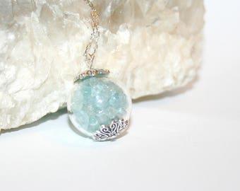 Aquamarines in a glass sphere pendant