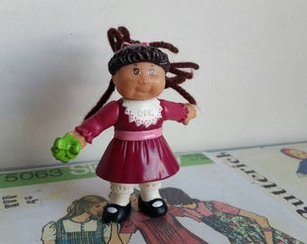 Vintage mini cabbage patch kid doll figure brown skin yarn hair pony tail arms move