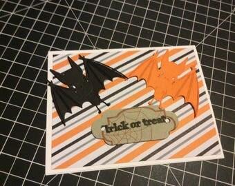 Trick or Treat Halloween card, handmade greeting card, black bat and orange bat with black and orange background
