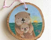 Hand Painted Otter Family Ornament on Wood by Megumi Lemons