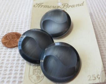 """3 Grey buttons, vintage, plastic, 1.12""""ins. New coat buttons on original card Armour Brand from HA KIDD button Co. Toronto. UNK16.11-25.16."""