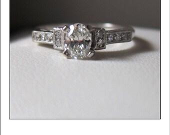Antique Deco Platinum .68 Ct. Diamond Engagement with .52 Ct center Oval SI1 H