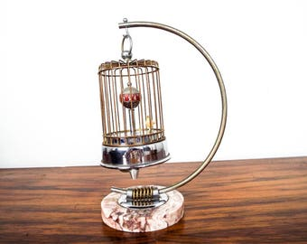 Vintage 1950s Bird Cage Mechanical Wind Up Clock w Rotating Bird Occupied Japan