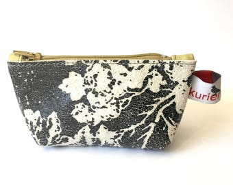 Small black and white printed coin pouch with mustard yellow zipper