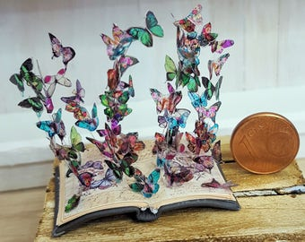 Miniature book sculpture butterflies