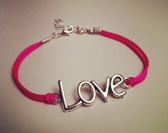 Neon pink cord bracelet with LOVE silver
