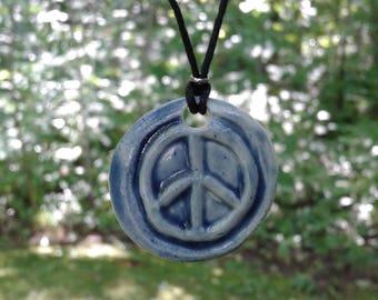 Blue Peace Sign Porcelain Pendant Necklace Clay Pottery Amulet on Hemp Cord Beach Boho Surfer