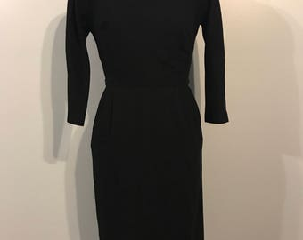 Stunner 1950s black wool wiggle dress