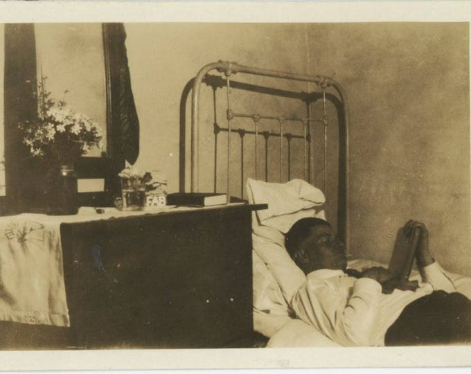 Vintage Snapshot Photo: Man Reading on Bed, Early 1900s (75583)