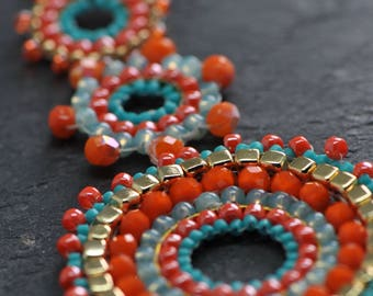 A Beautiful Turquoise and Tangerine Necklace made with Czech glass crystals, seed beads, gold tone copper necklace, brickstiched