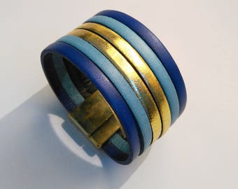 indigo sky and gold leather with magnetic gold cuff