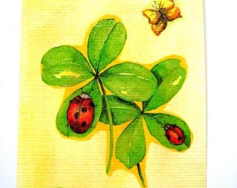 Card mailing a lucky 4 leaf clover.