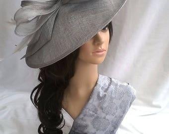 Silver Grey metallic large Hatinator Sinamay and feathers on a Headband.