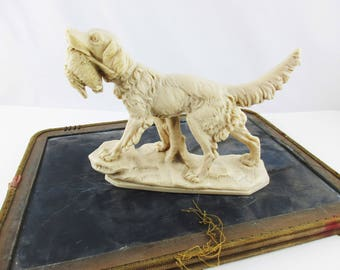 An 'A. Santini' Dog Sculpture - Made in Italy - Hunting Dog - Figure in Ivory Composite Resin - Reproduction Retriever Dog With Goose