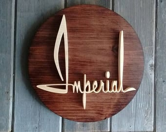 1961 Chrysler Imperial Script Emblem Round Wall Plaque-Unique scroll saw automotive art created from wood for your garage, shop or man cave.