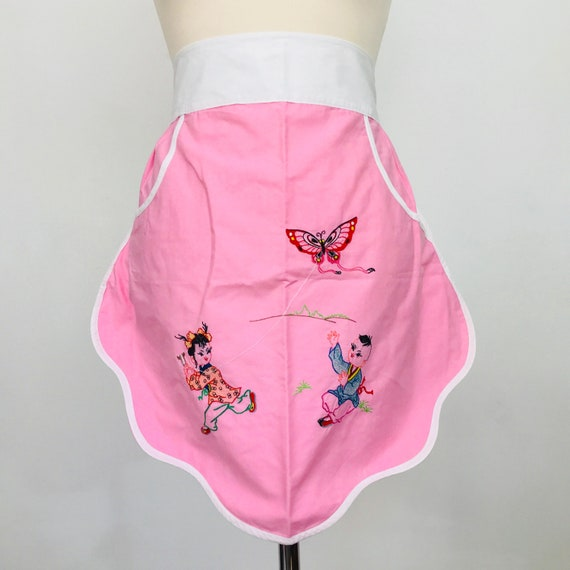 Vintage novelty apron kitchen pinny half apron souvenir Chinese character 1960s pink cotton embroidery kite children