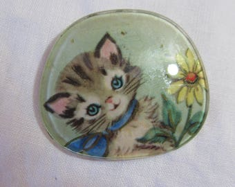 Eyeglass lens brooch; child's cat and flowers brooch; 1950's