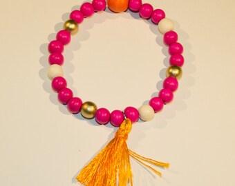 Bracelet multicolored wood beads, Fuchsia, orange, gold and white