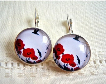 Earrings, metal silvery, glass domes, poppies and birds. Red, White, black.